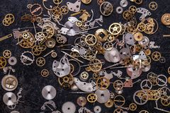 Gears on the table. Details, technology. Heap of small gears on the table Royalty Free Stock Photos