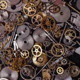 Gears on the table. Details, technology. Heap of small gears on the table Stock Photography