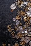 Gears on the table. Details, technology. Heap of small gears on the table Stock Photos