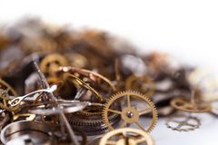 Gears on the table. Details, technology. Heap of small gears on a white background Royalty Free Stock Photos
