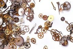 Gears on the table. Details, technology. Heap of small gears on a white background Royalty Free Stock Images