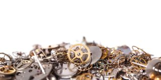 Gears on the table. Details, technology. Heap of small gears on a white background Stock Image