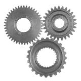 Gears. Three metal gears on plain background Royalty Free Stock Photos