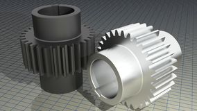 Gears - Toothed wheels. Two straight toothed wheels, one in black iron and one in nickel, on a measuring plane Stock Photos
