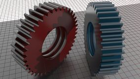 Gears - Toothed wheels. Two straight toothed wheels, red and blue plastic material, on a measuring plane Stock Photo