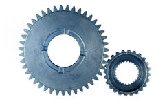 Gears. Two metal gears on plain background Royalty Free Stock Photography