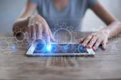 Gears on virtual screen. Business strategy and technology concept. Automation process. Gears on virtual screen. Business strategy and technology concept Royalty Free Stock Photo