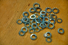 Gears and Washers on Wooden Background. Close Up of Gears and Washers on a Wood Background royalty free stock images
