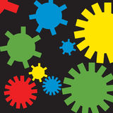 Gears and Wheels. A group of mechanical gears in primary colours over black background Stock Photo