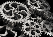 Gears wheels from rusty metal on black background. Highly detail render Stock Photos