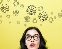 Gears with young woman royalty free stock images