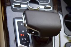 Gearshift lever in a modern car. The cereal plan royalty free stock images