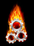 Gearwheel in fire. Illustration on black background for design Stock Photo