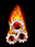 Gearwheel in fire Stock Photo