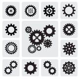 Gearwheel mechanism icon. Vector black gearwheel mechanism icon set on gray Royalty Free Stock Images
