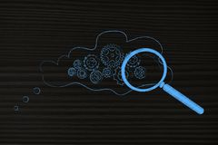 Gearwheel mechanizmu inside myśli bąbel z powiększać - szkło obrazy stock