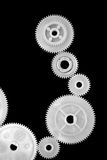 Gearwheels 1. Seven matching gearwheels with black background Stock Photos