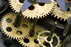 Gearwheels inside clock mechanism. Royalty Free Stock Photography