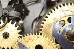 Gearwheels inside clock mechanism. Stock Photo
