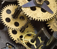 Gearwheels inside clock mechanism. Royalty Free Stock Photo