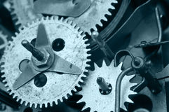 Gearwheels inside clock mechanism. Macro Stock Photography