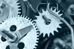 Gearwheels inside clock mechanism. Macro Royalty Free Stock Image