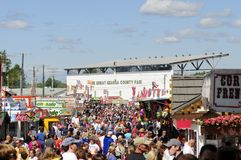 Geauga County Fair. Crowds throng the midway at the 188th annual Great Geauga County Fair, the state's olderst continuously running fair, in Burton, Ohio, on Royalty Free Stock Photos
