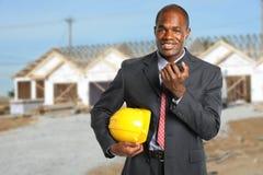 Gebäude-Manager an der Baustelle Stockbild