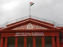 Gebäude Obersten Gerichtshofs Bangalores, Karnataka, Indien - 5. September 2009 rote Farbe-Karnataka Lizenzfreies Stockbild