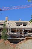 Gebäude oder Baustelle mit Kran Stockbild