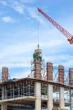 Gebäude und Bauarbeiter Stockfotos