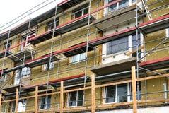 Gebäudefassadeerneuerung Stockfotos