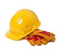 Gebäudesturzhelm und Schutzhandschuhe Lizenzfreie Stockfotos