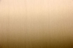 Gebürstetes goldenes Messingmetallabstellgleis lizenzfreie stockfotografie