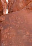 Gebürtiges indianisches Schreiben auf Felsen Stockfoto