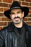 Gebaarde mens in cowboyhoed Royalty-vrije Stock Fotografie