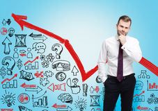 Gebaarde zakenman, rode grafiek Stock Foto's