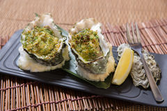 Gebackene Austern mit Zitrone Stockbild
