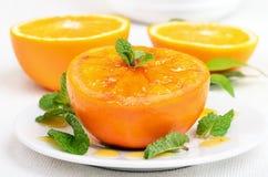 Gebackene orange Frucht verzierte Minze Stockfotografie