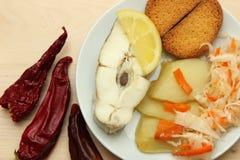 Gebackener Weißfisch mit Zitrone Lizenzfreies Stockbild