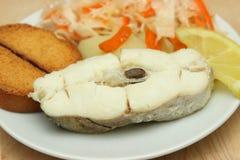 Gebackener Weißfisch mit Zitrone Stockbilder