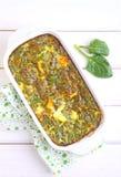 Gebackenes Omelett mit Spinat Lizenzfreie Stockfotos