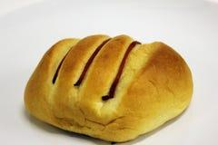 Gebakken brood op een witte achtergrond Royalty-vrije Stock Fotografie