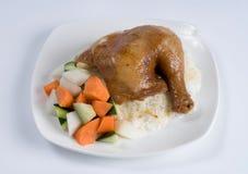 Gebakken kippenbeen over rijst royalty-vrije stock afbeelding
