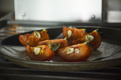 Gebakken tomaten met knoflook Royalty-vrije Stock Fotografie