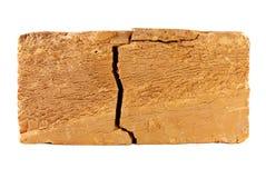 Gebarsten baksteen. Stock Afbeelding