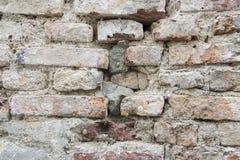 Gebarsten concrete en Oude bakstenen muurachtergrond Royalty-vrije Stock Afbeeldingen