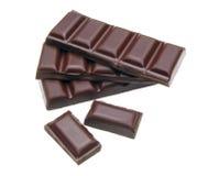 Gebarsten en gestapelde chocolade Stock Foto