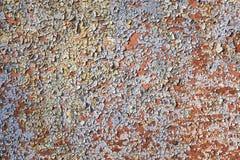 Gebarsten geschilderde muur Oude gepelde verfachtergrond stock foto's
