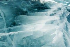 Gebarsten ijsachtergrond stock afbeeldingen